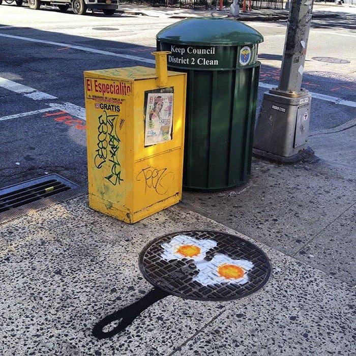 Genius Street Artist eggs cooking on pan
