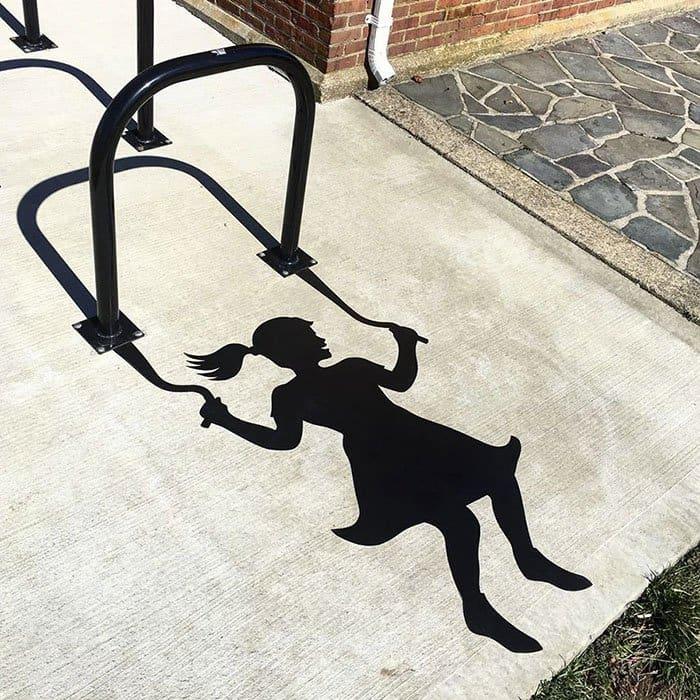 Genius Street Artist swinging silloutte