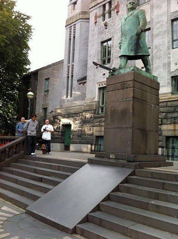 Genius Vandalism statue skateboarding