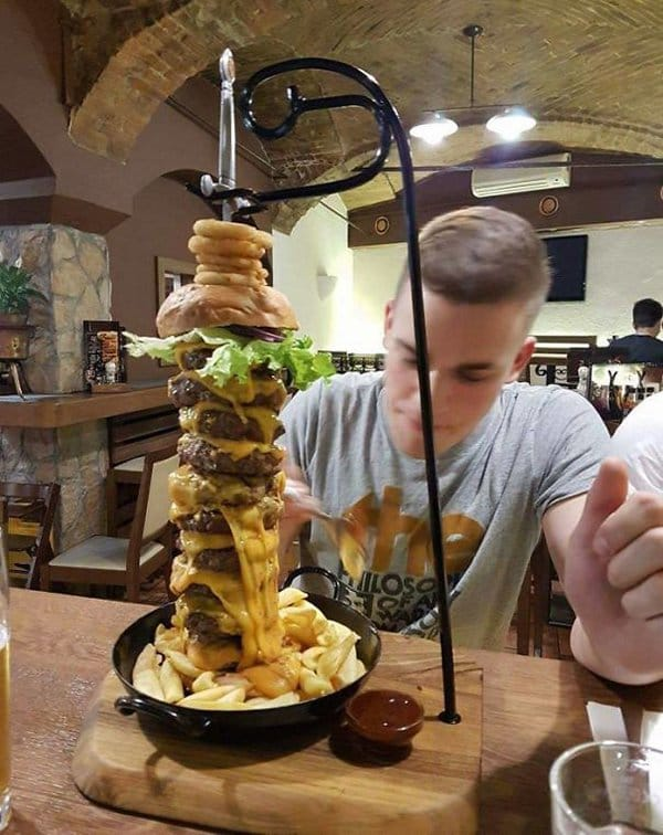 Hipster Restaurants Went Too Far With Food Serving burger with sword through it