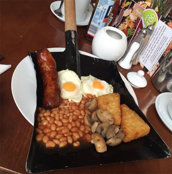 Hipster Restaurants Went Too Far With Food Serving fry up on a shovel