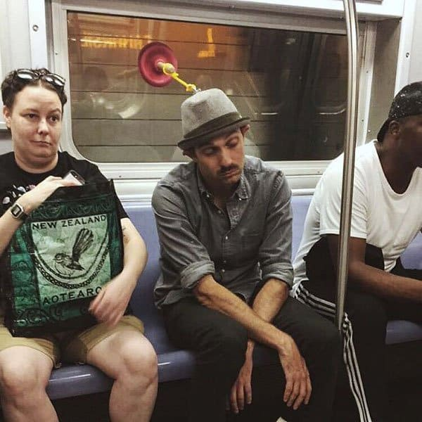 Weirdest People Ever Spotted On The Subway plunger hat
