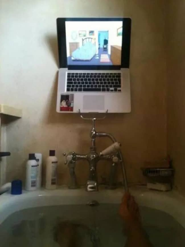 Clever Life Hacks laptop balanced on shower