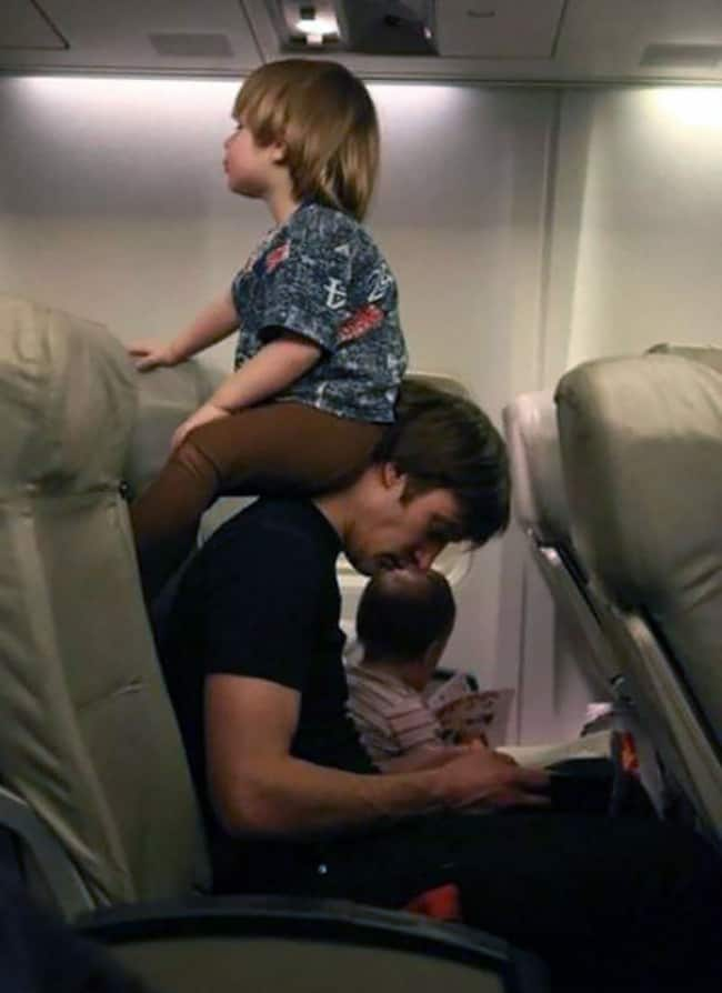 Crazy Things Spotted On Flights kid sitting on neck