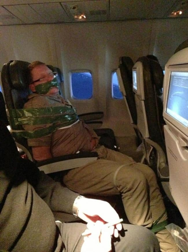 Crazy Things Spotted On Flights man taped to seat