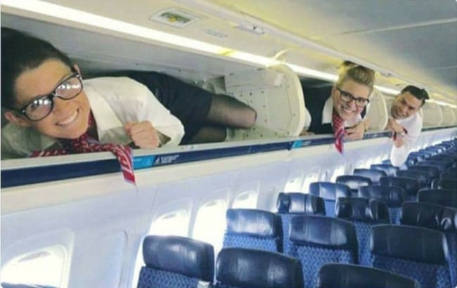 Crazy Things Spotted On Flights stewardesses in over head storage