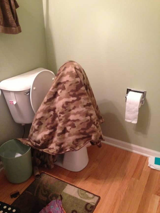 Kids Being Strange blanket on toilet
