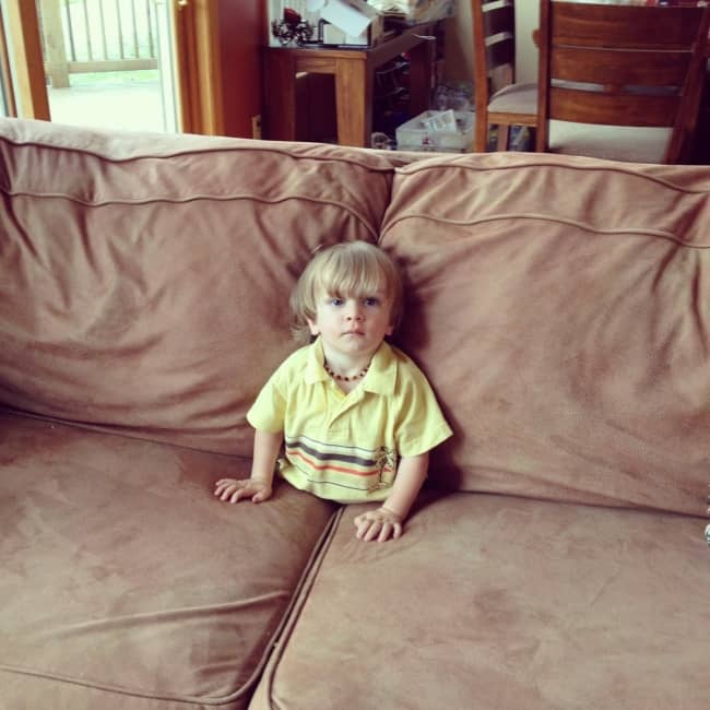 Kids Being Strange sitting inside sofa