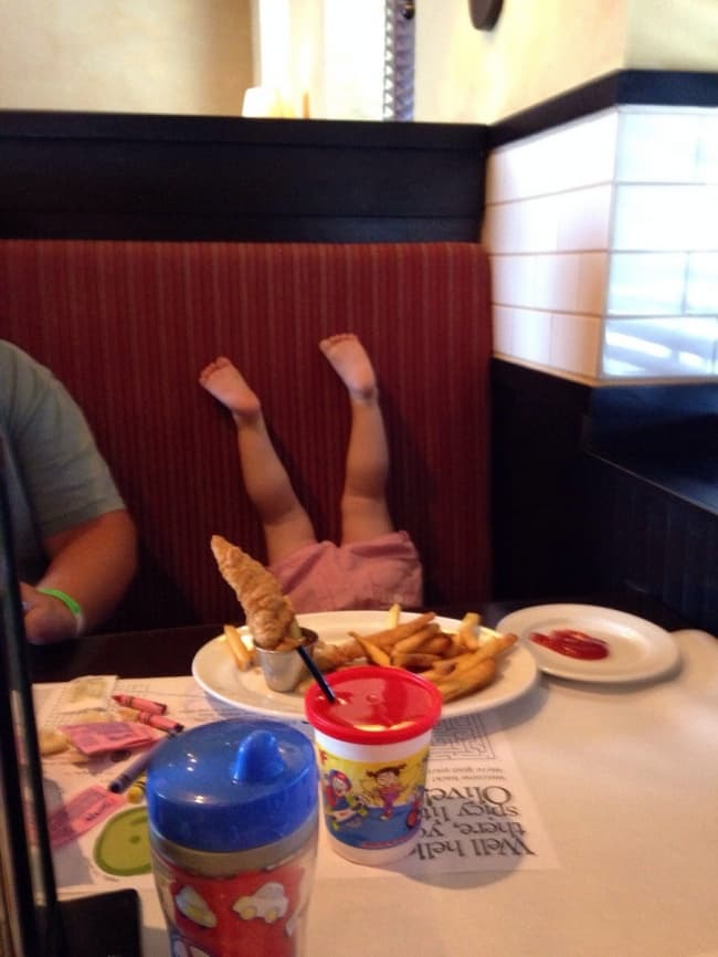 Kids Being Strange upside down at dinner