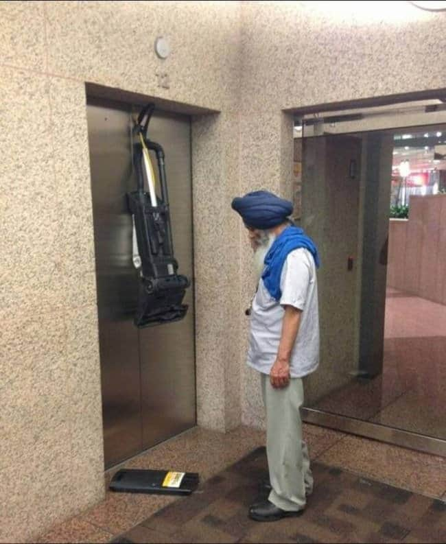 Awful Day At Work vaccum stuck in lift