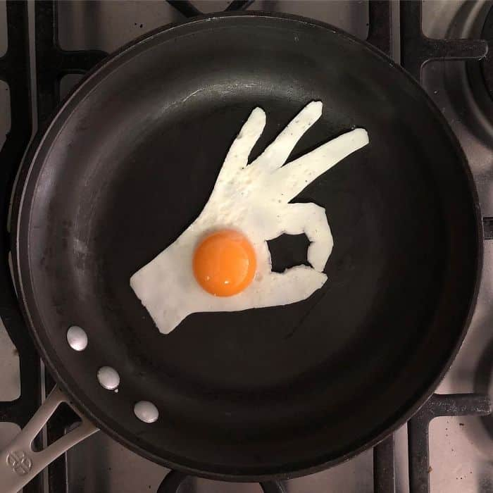 Breakfast Eggs Into Works Of Art hand