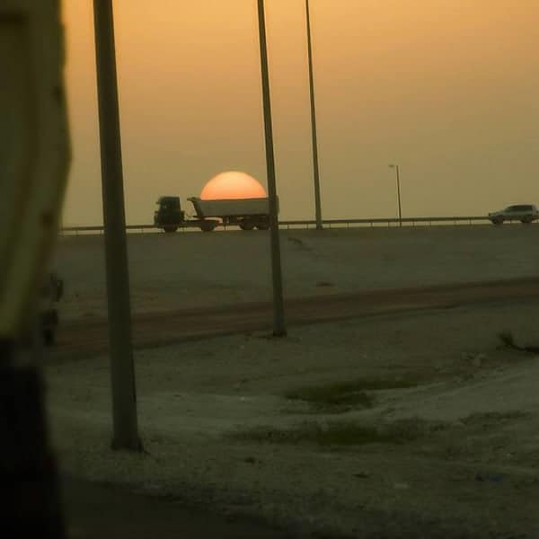 Perfectly Timed Photos lorry carrying sun
