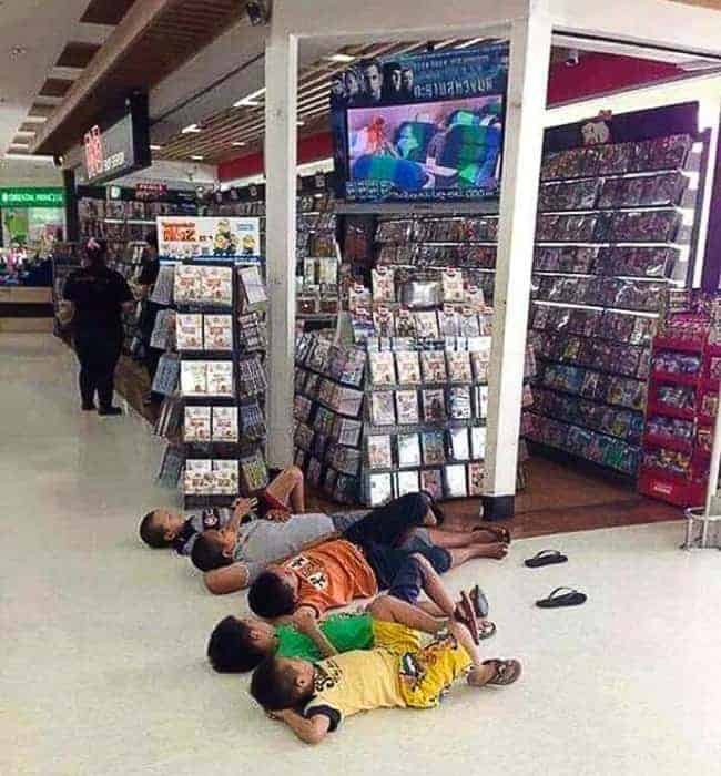 The Joys Of Shopping With Kids lying on floor tv