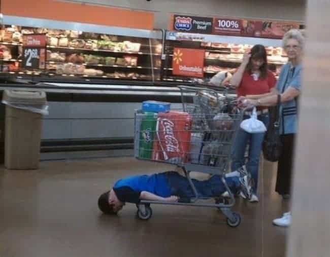 The Joys Of Shopping With Kids underneath trolley