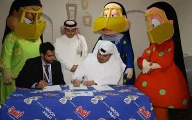 contract-signing-with-scary-mascots-at-the-back