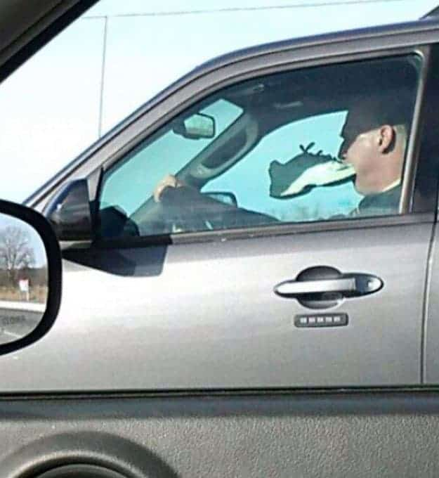 driving-man-with-a-rubber-shoe-in-his-mouth