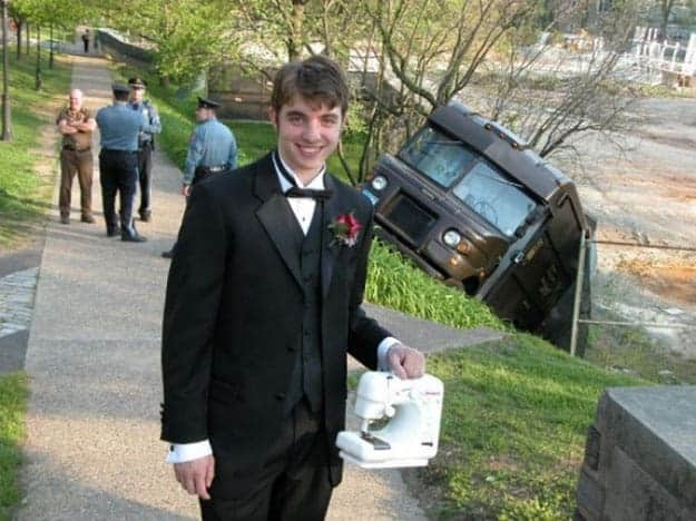 man-in-tux-carrying-a-sewing-machine