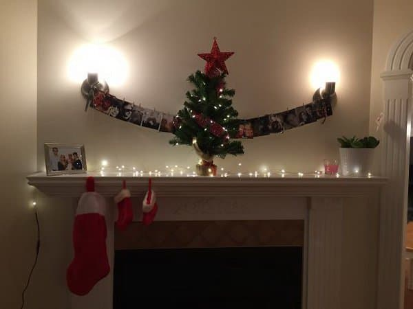 mini-christmas-tree-on-top-of-a-mantel