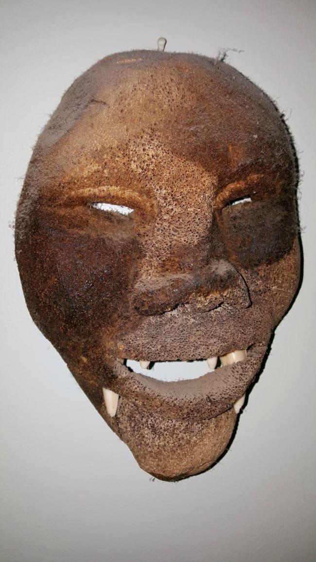 creepy-mask-in-attic