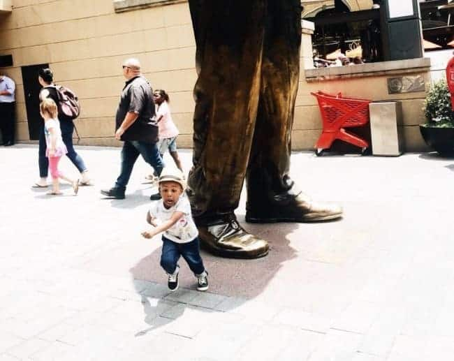 kid-running-from-falling-statue
