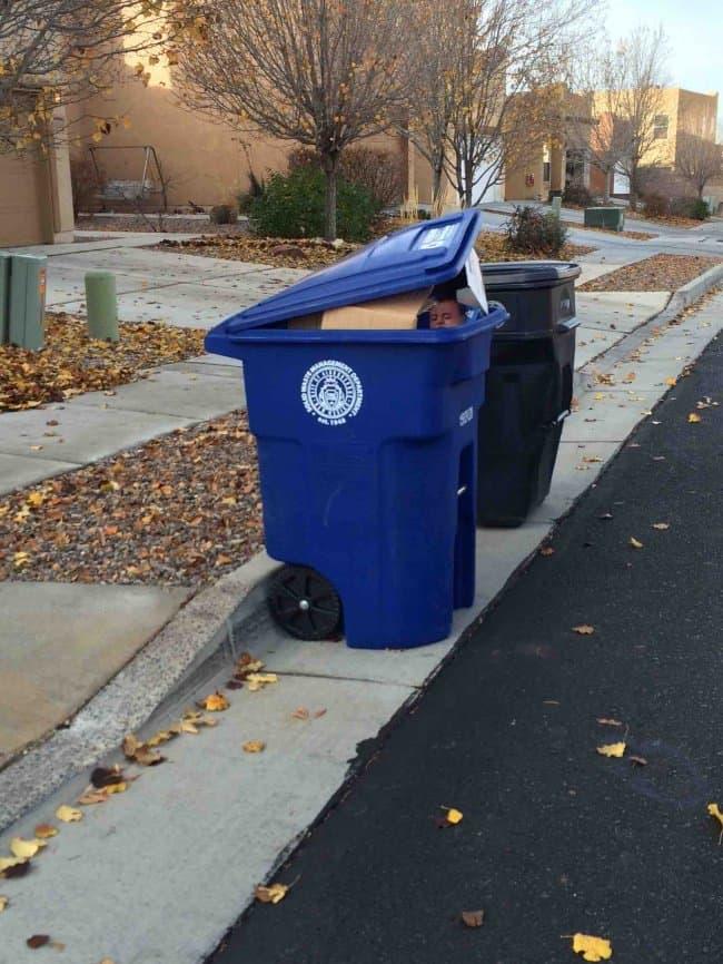 mysterious-baby-on-trash-bin