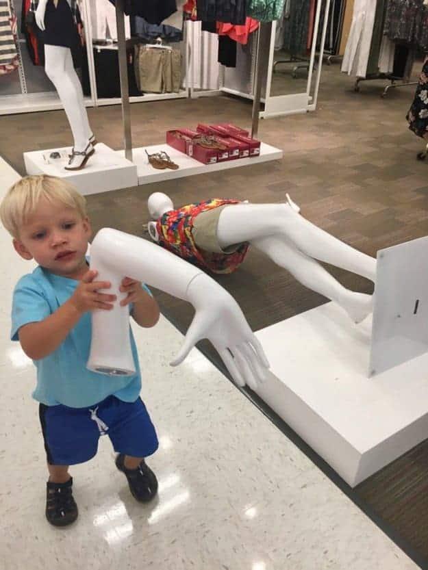 boy-holding-a-mannequins-hand