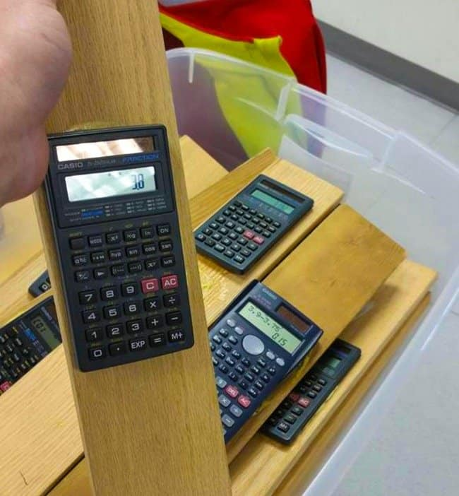 calculators-glued-on-wooden-planks-inventive-people