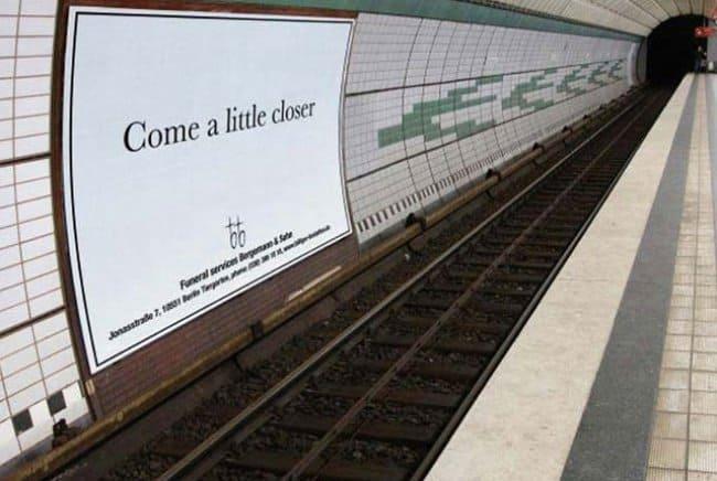come-a-little-closer-ad-on-train-tracks