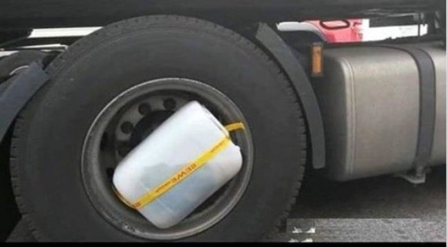 container-taped-to-a-tire