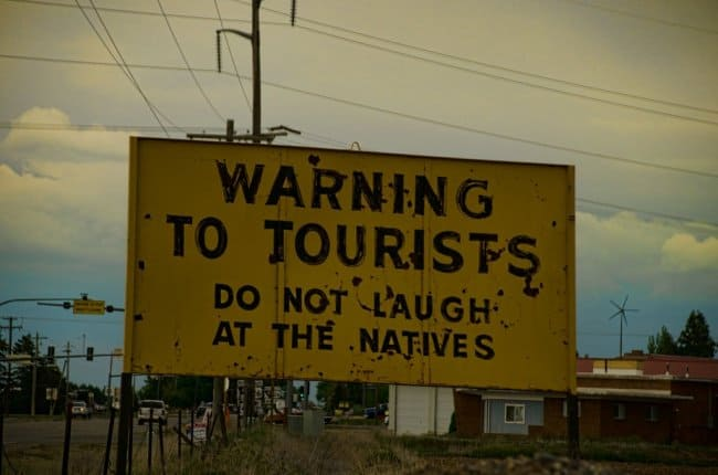 do_not_laugh_at_the_natives_sign