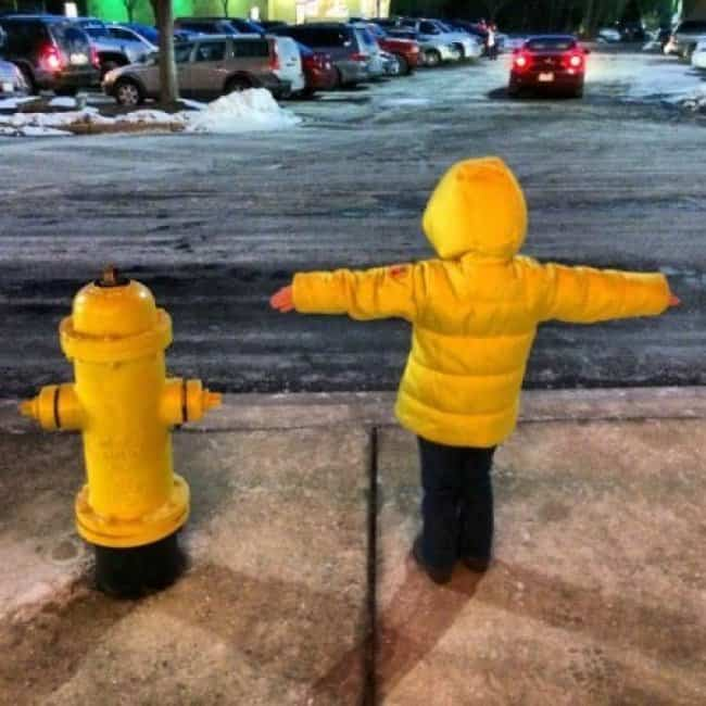 fire_hydrant_and_boy_wearing_yellow_jacket_look_alike