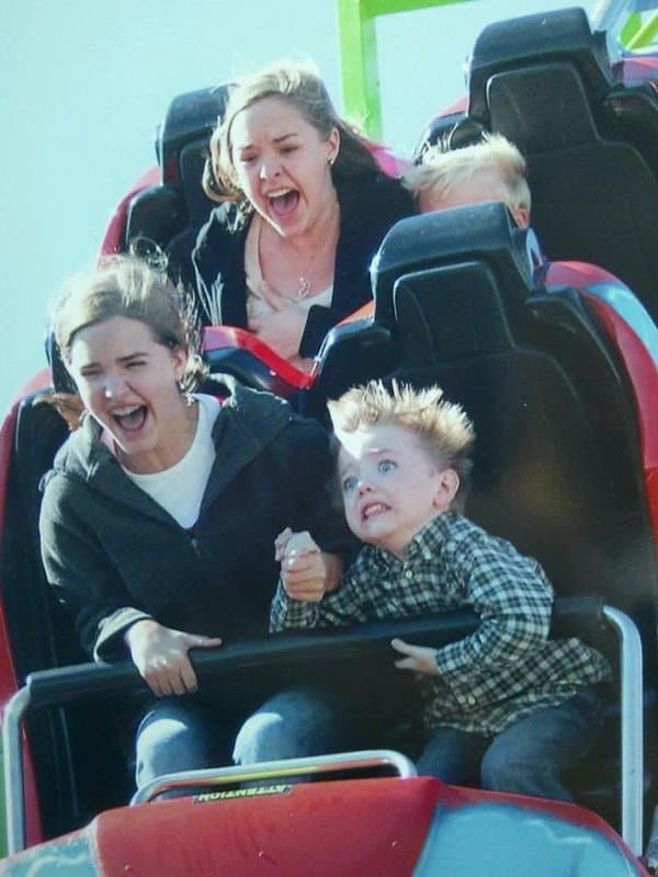 frightened-kid-on-a-roller-coaster
