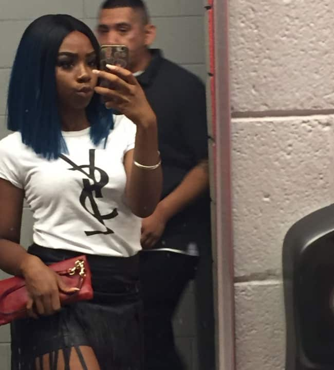 girl_taking_selfie_inside_men_bathroom