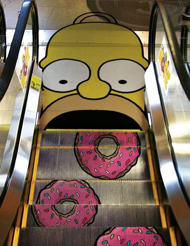 creative_escalator_ads_homer_simpson_eats_donuts
