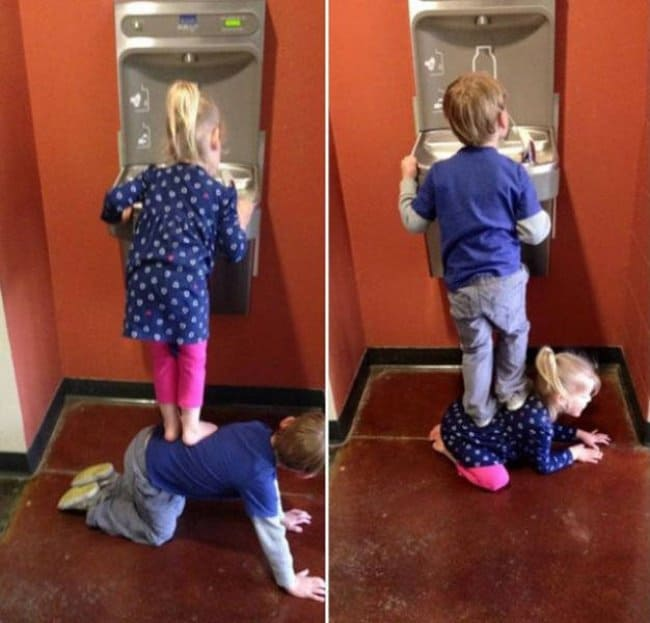little-boy-and-girl-taking-turns-at-the-drinking-fountain