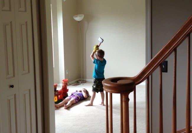little-boy-holding-an-ax