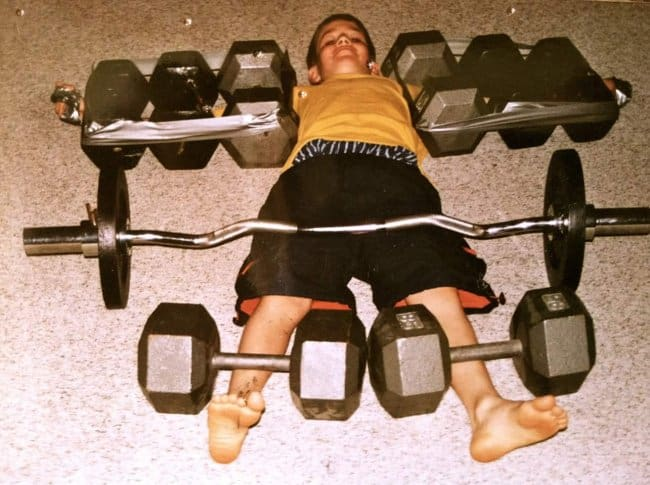 little-boy-trapped-between-weights