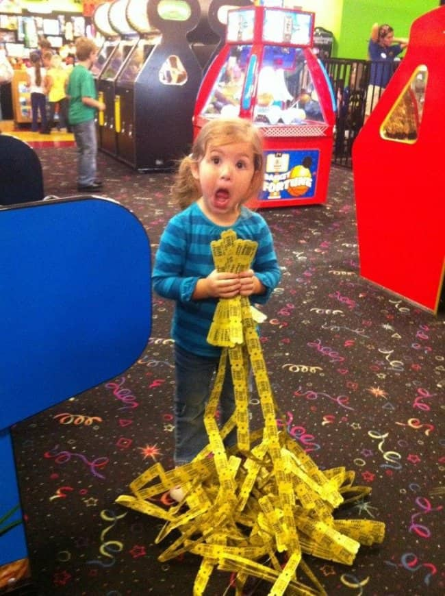 little-girl-holding-lots-of-tickets-at-the-arcade