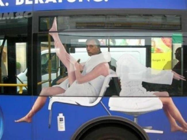 man-sitting-on-a-bus-with-a-nivea-ad-outside