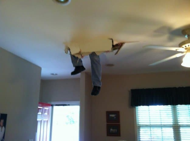 man-stuck-in-the-ceiling