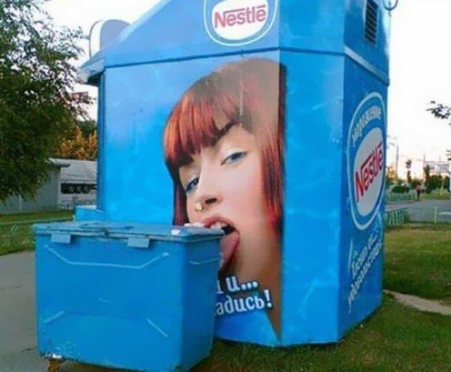 nestle-kiosk-ad-licking-a-garbage-disposal