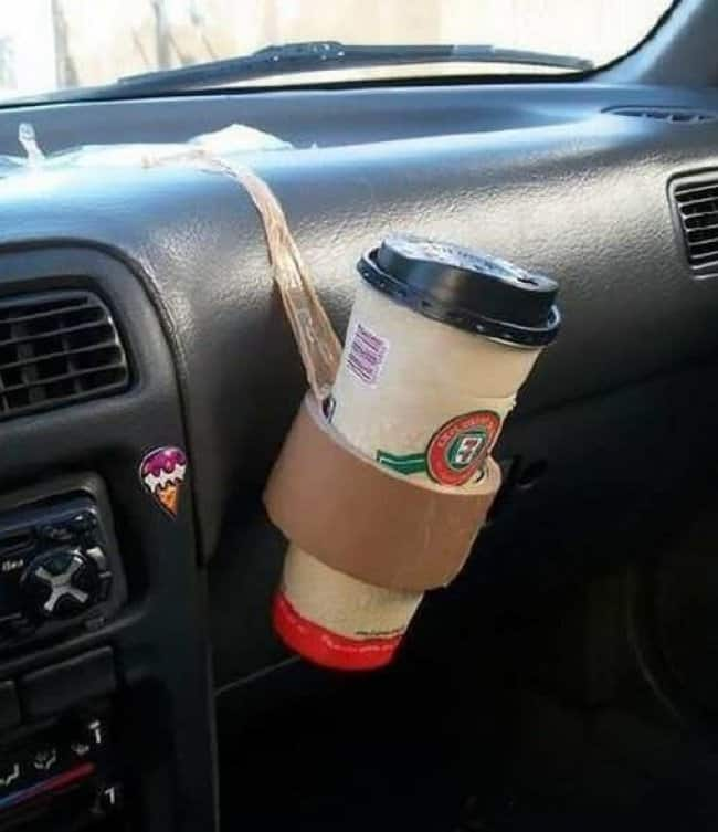 bad advice of a make shift cup holder in a car using tape