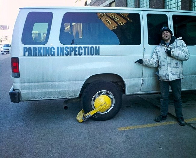 parking_inspector_car_got_parking_violation_self_irony