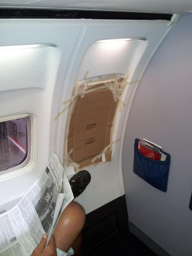 piece-of-carton-taped-to-a-plane-window
