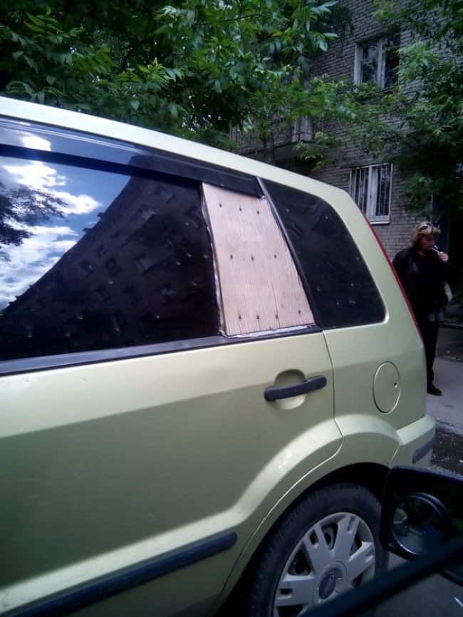 piece-of-wood-attached-to-a-broken-car-window