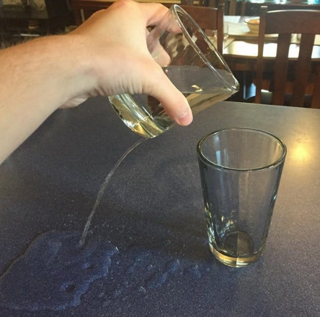spilling-water-while-filling-a-glass