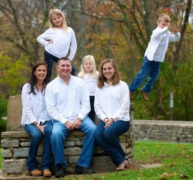 boy-jumping-away-hilarious-family-photos