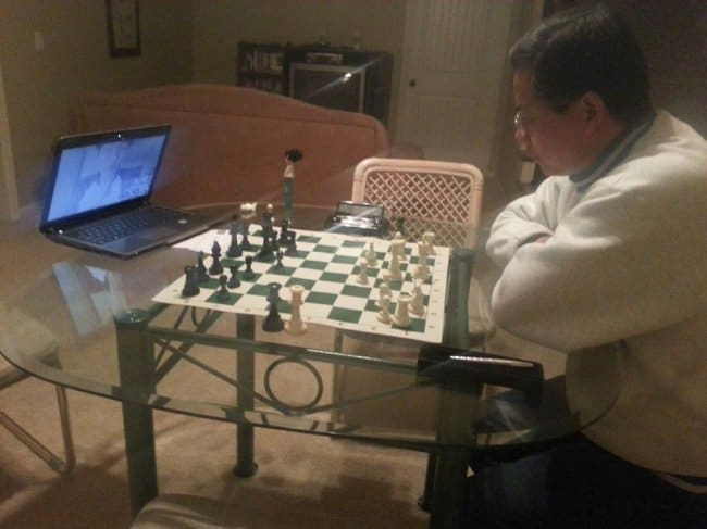 boyfriend-and-father-playing-chess