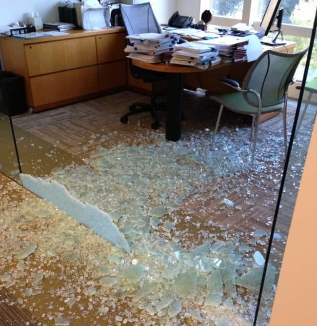 crashing-through-glass-wall-in-the-office-miserable-people