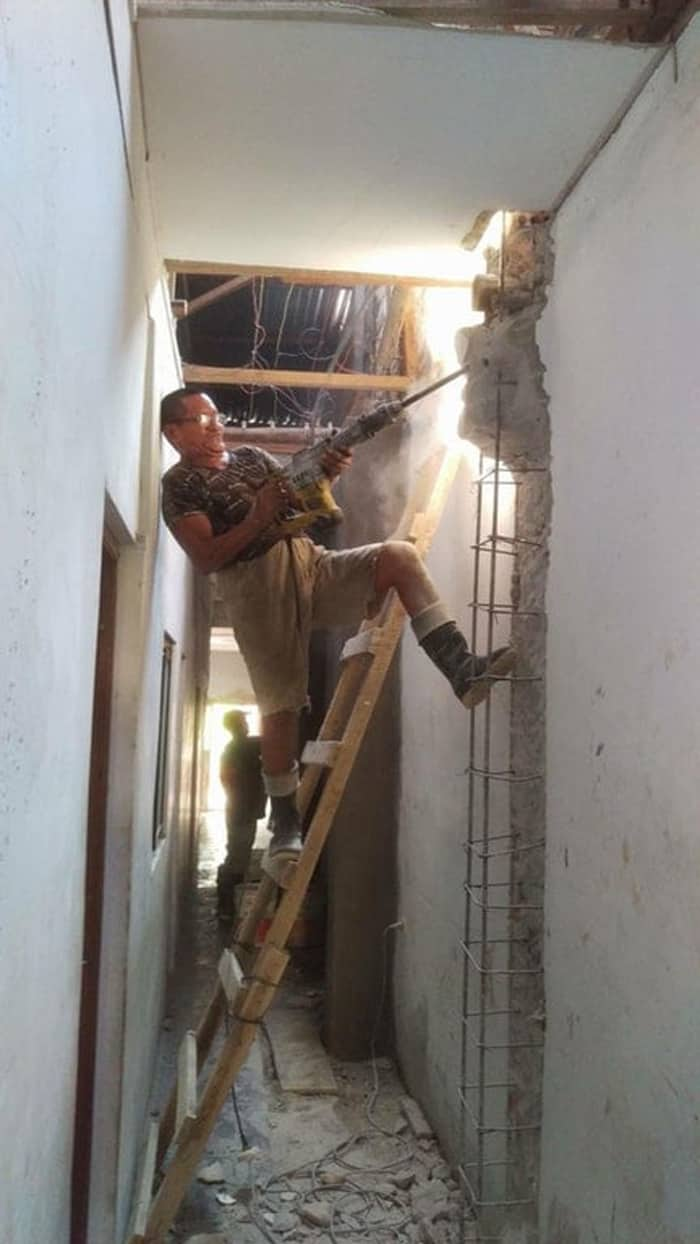 drilling-walls-on-a-ladder-audacious-workers